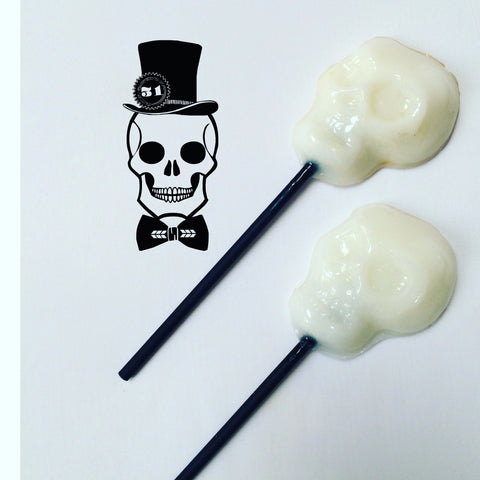 White skull shaped lollipops