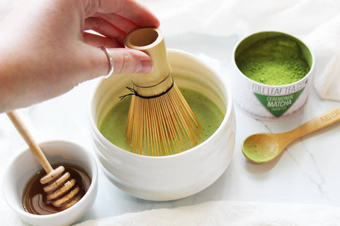 whisking ceremonial matcha