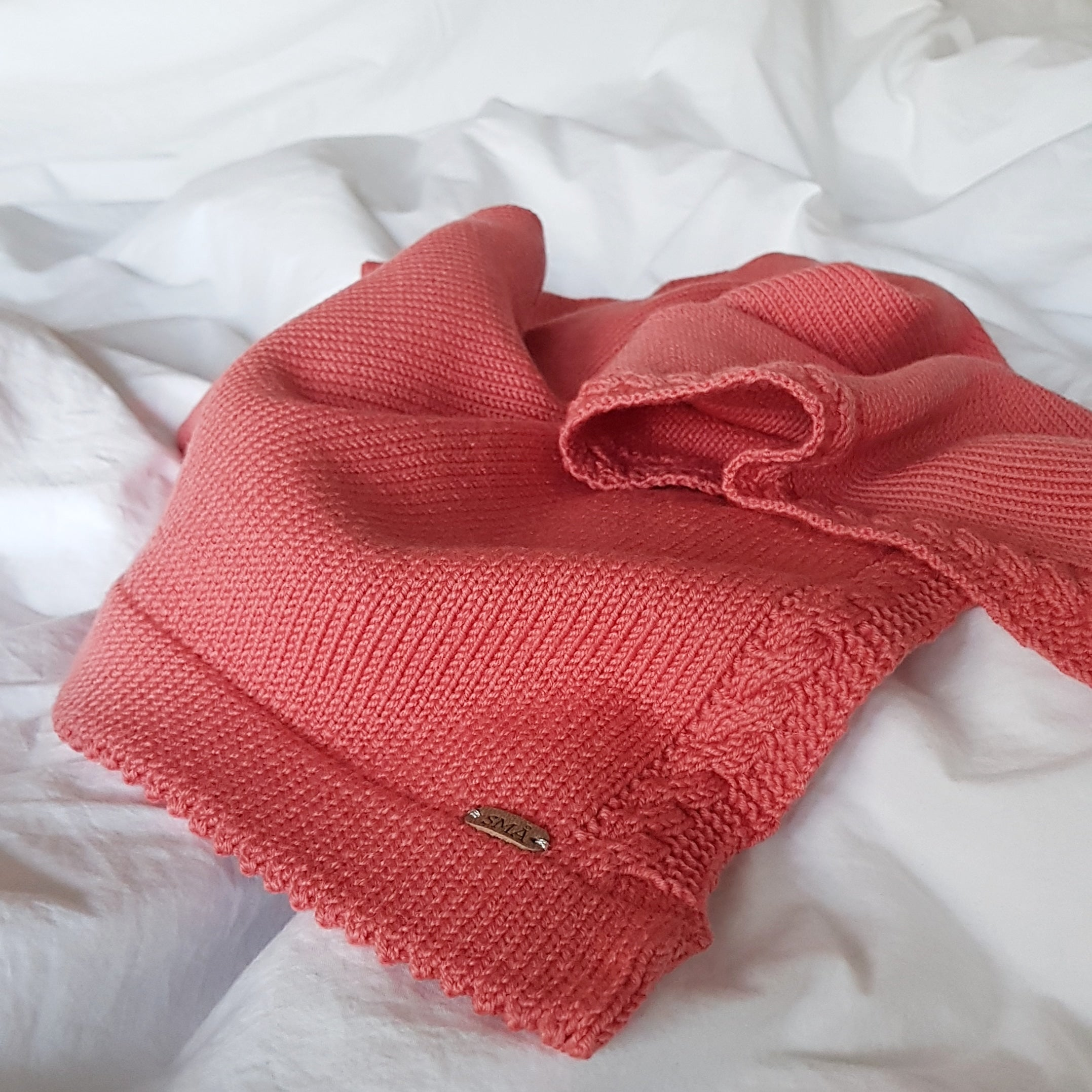 Soft knitted blanket, coral