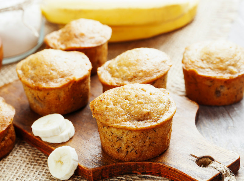Banana apple muffins on a wooden board
