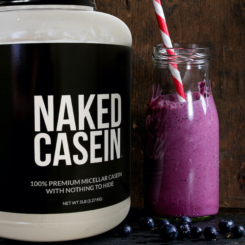 Naked Casein product image with a tub of Naked Casein next to a berry smoothie