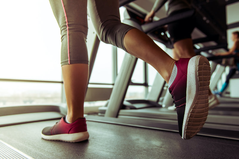 Close up of a women's shoes while walking on a treadmill