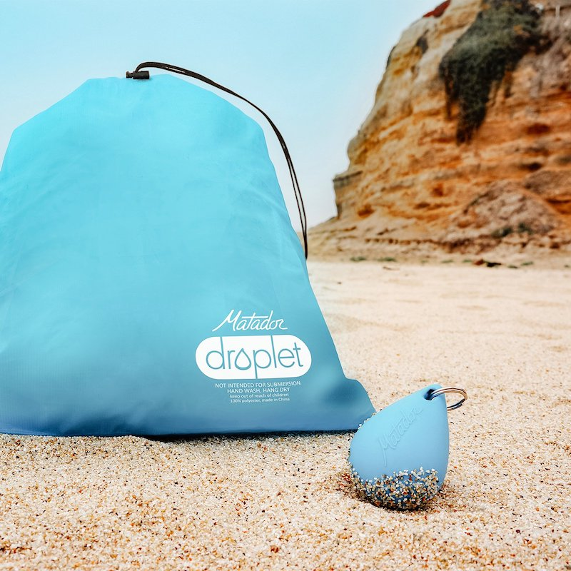 Product image of the Droplet waterproof bag, next to the keyring it fits into