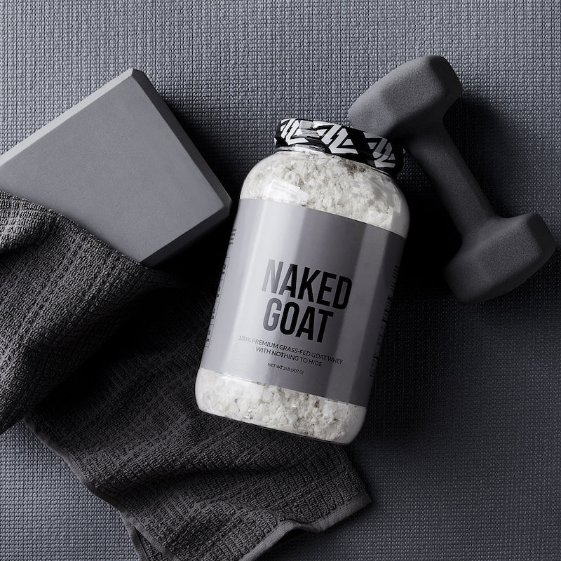Naked Goat product image with a tub of Naked Goat on it's side with gym equipment