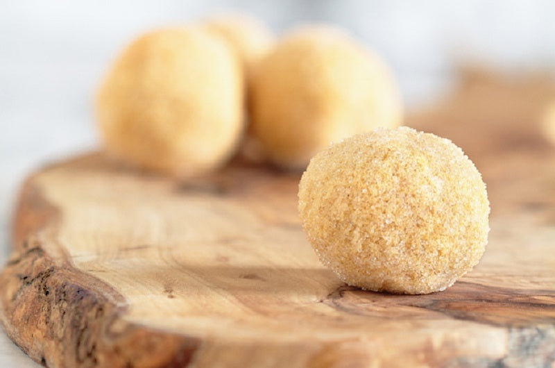 Image of keto fat bomb balls on a wooden surface