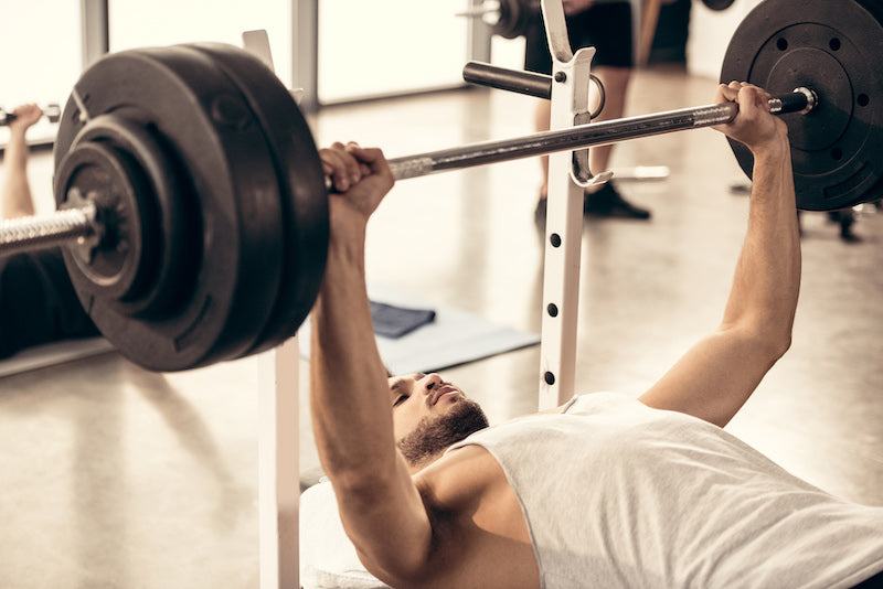 Man doing a benchpress workout in a gym