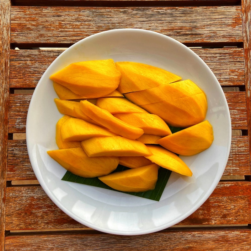 Aerial view of mango slices on a plate
