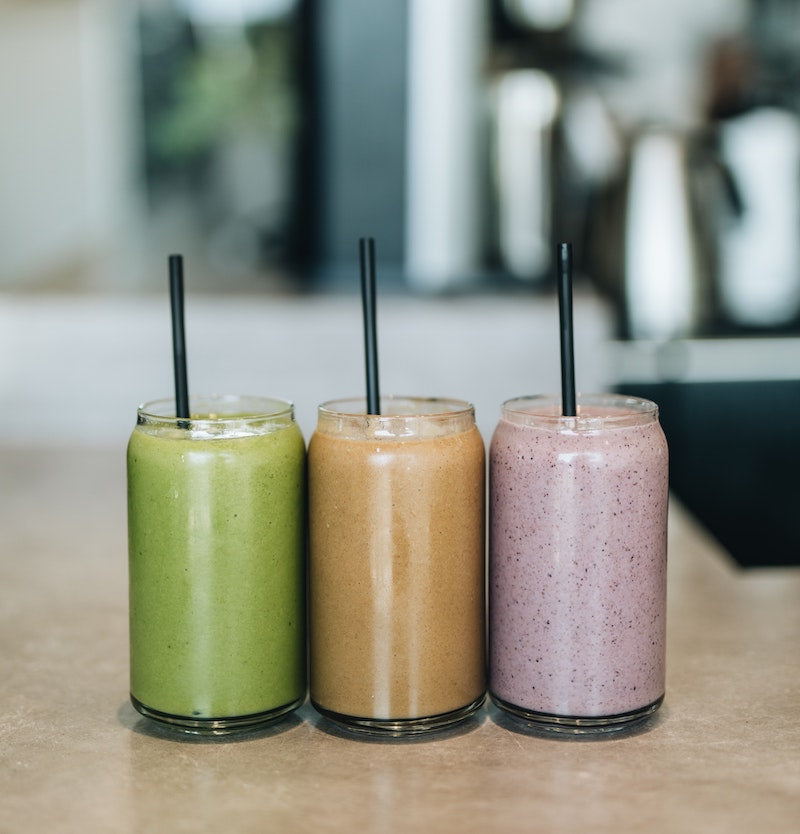 Three different flavored meal replacement shakes on a countertop