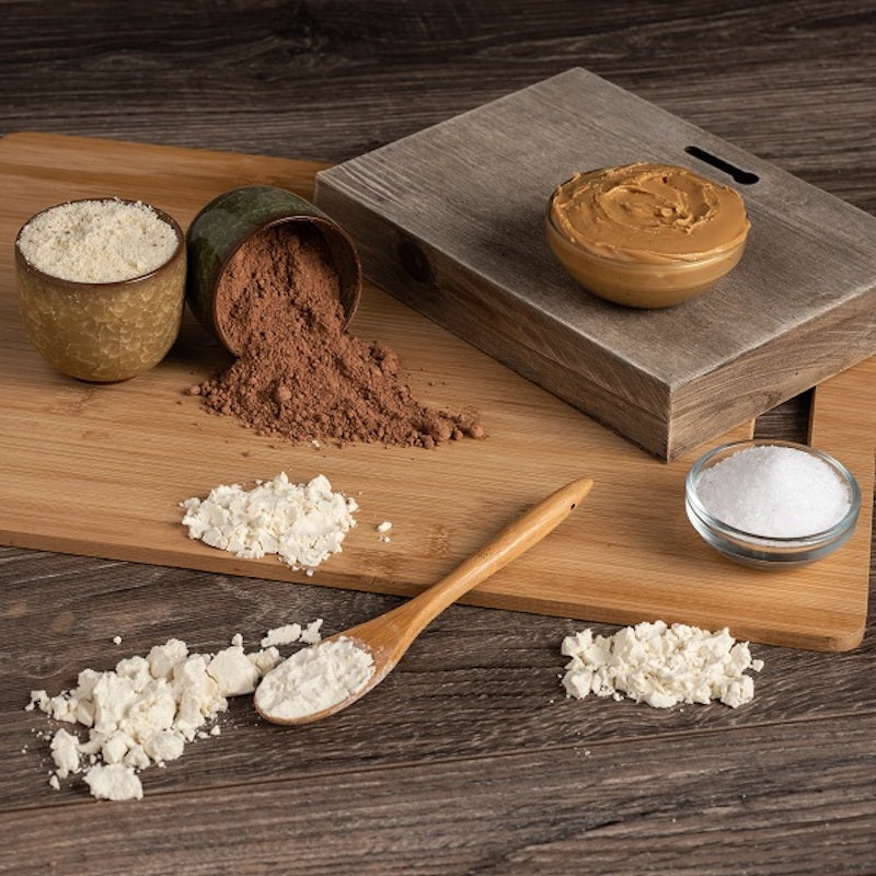 Array of Naked Bar ingredients on a wooden table