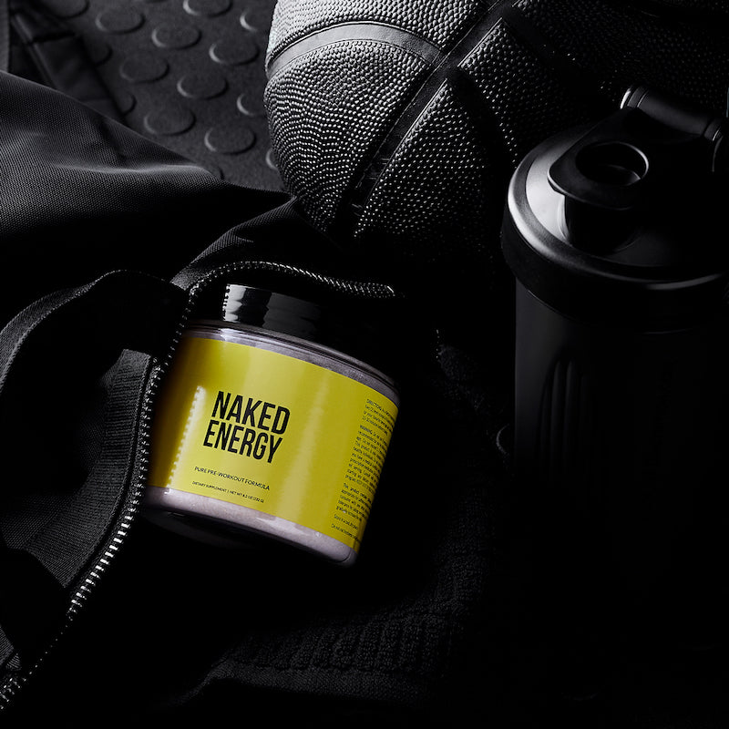 Product image of Naked Energy next to a black gym bag