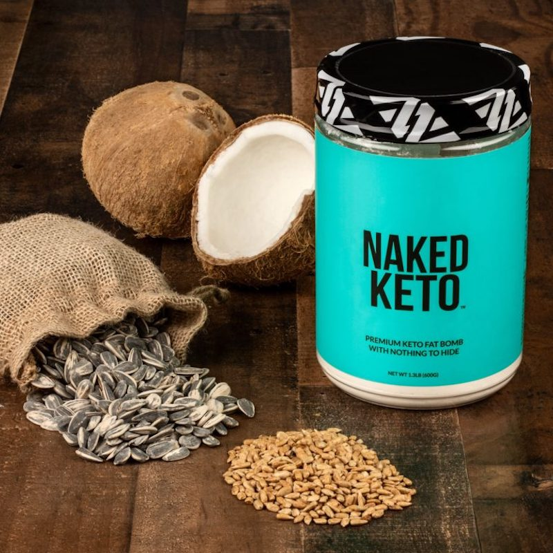 Naked Keto product image with some of the product's ingredients on the table surrounding it