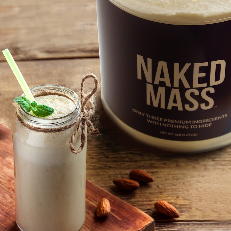 Naked Mass product next to a protein shake