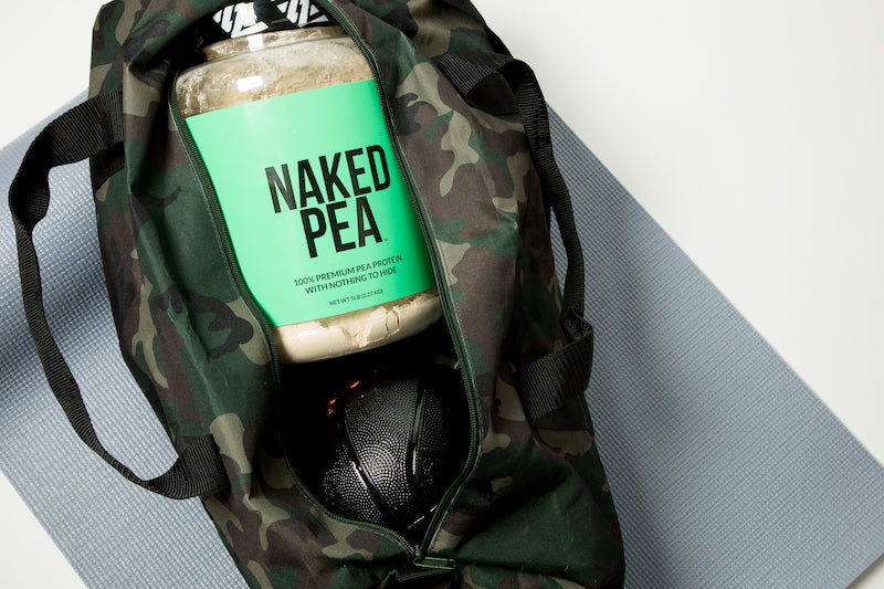 Tub of Unflavored Naked Pea in a camo gym bag next to a sports ball