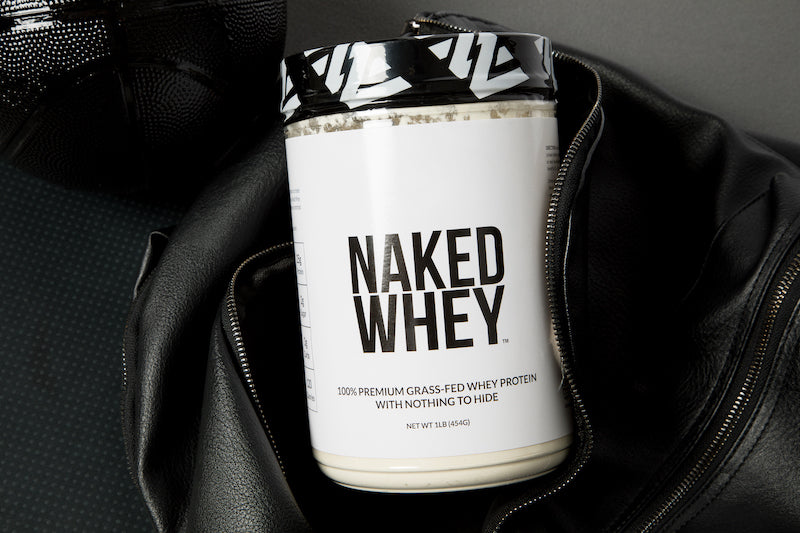 1lb tub of Naked Whey in a gym bag