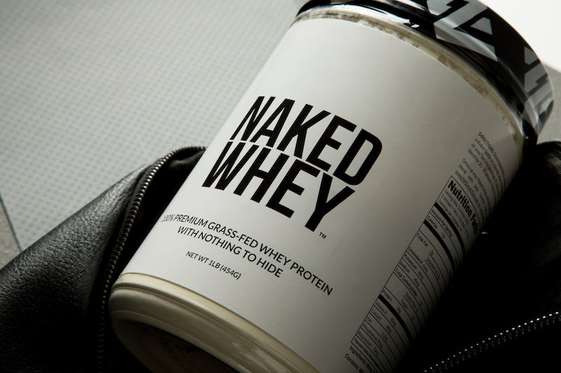 Tub of Naked Whey in a black gym bag