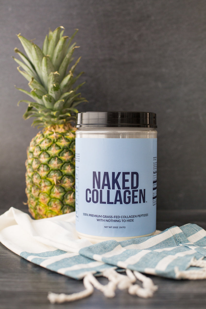 Naked Collagen on a table with a beach towel and a pineapple