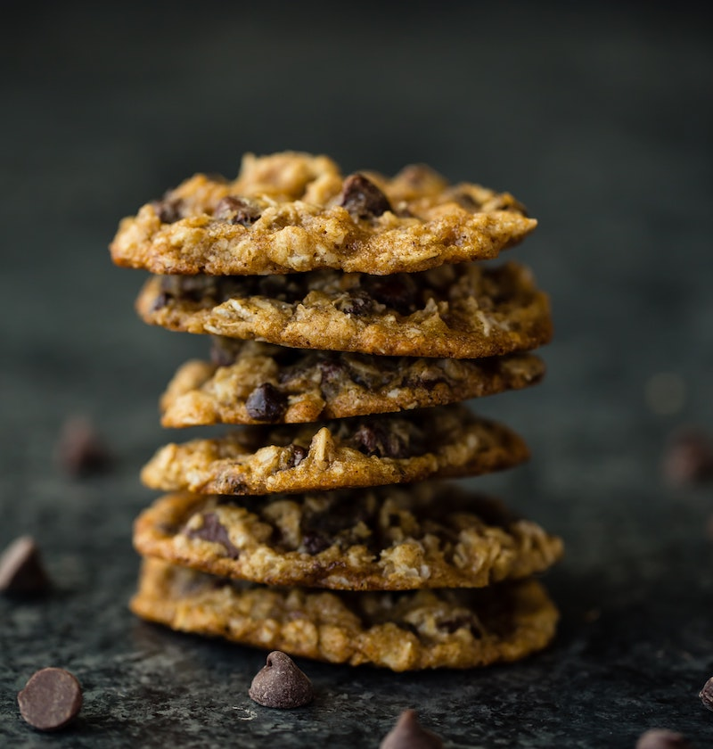 No bake protein cookies in a stack against a dark background