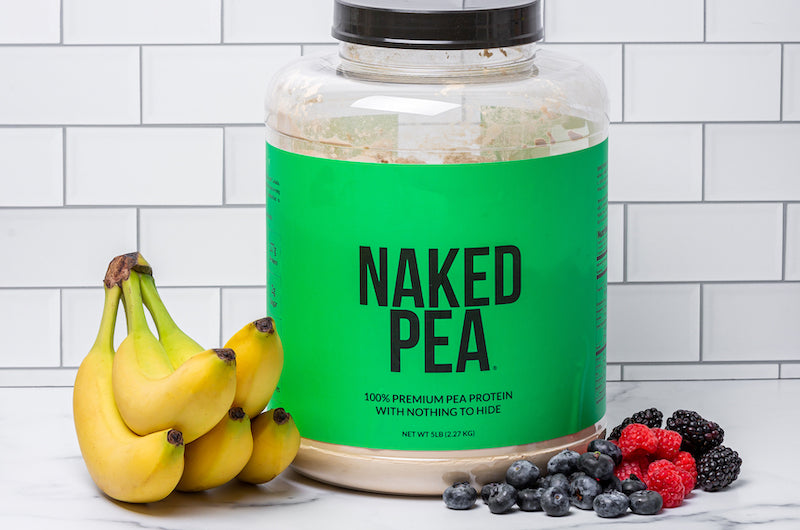 Image of Naked Pea sitting on a white counter against a tiled background