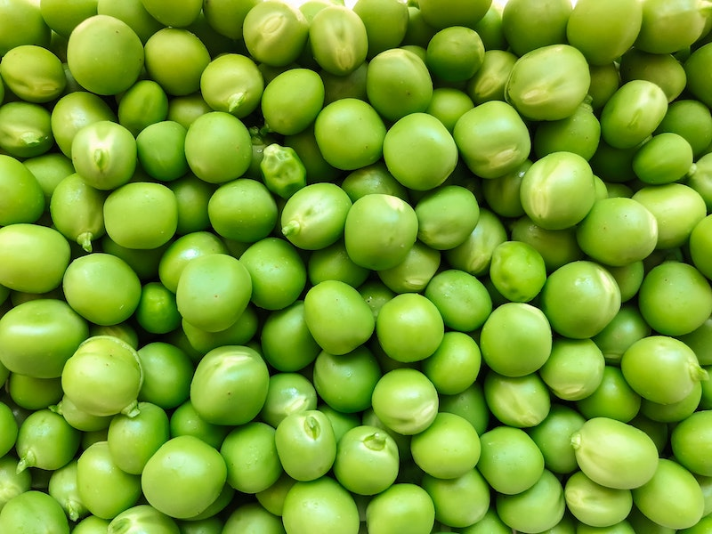 Closeup of a group of raw peas