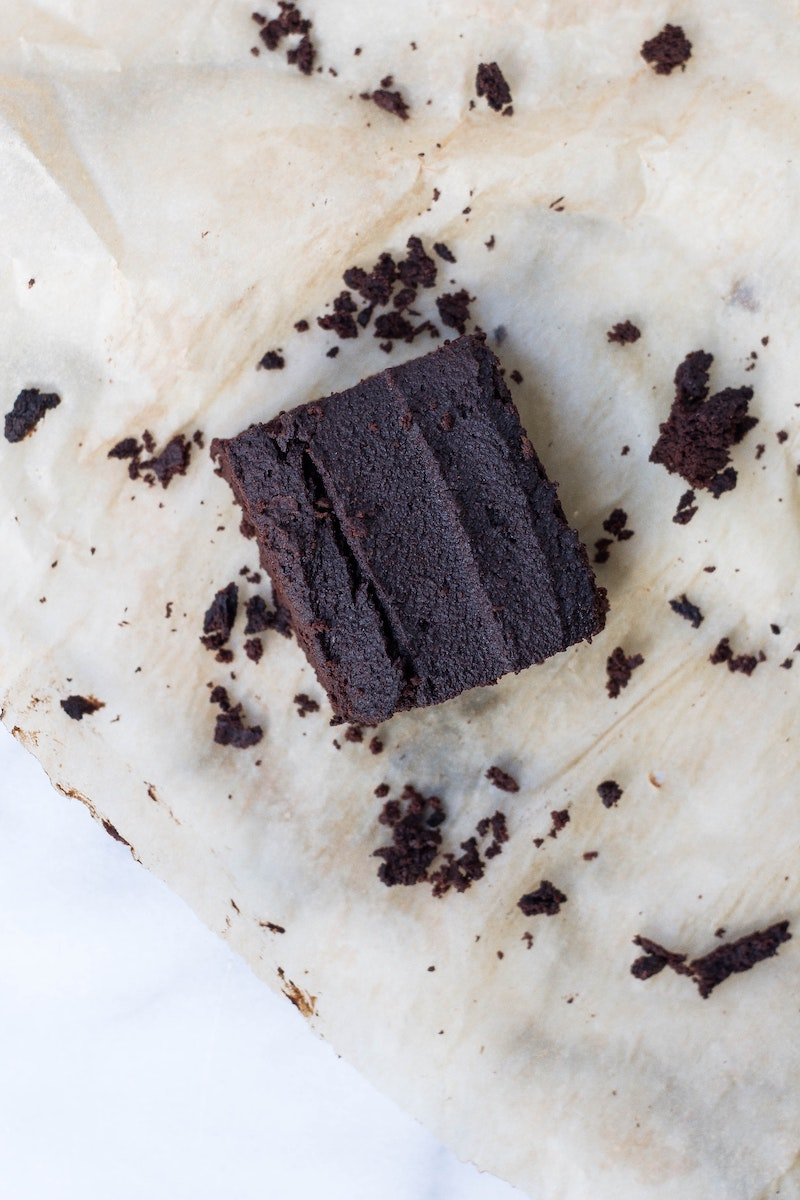 Chocolate whey protein powder brownie on parchment paper