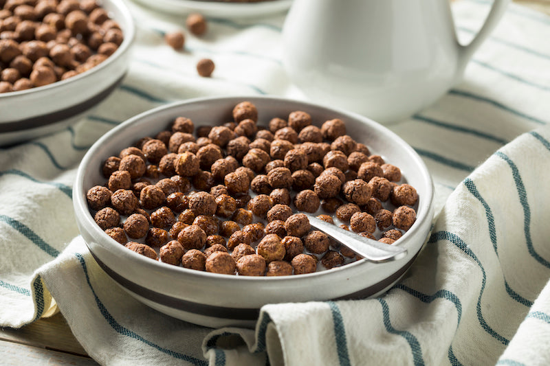 Bowl of protein cocoa puffs and milk