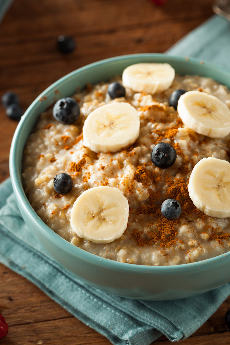 Protein oatmeal, topped with blueberries, bananas, and cinnamon