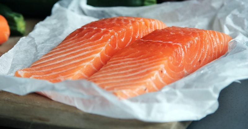 Pieces of salmon on parchment paper