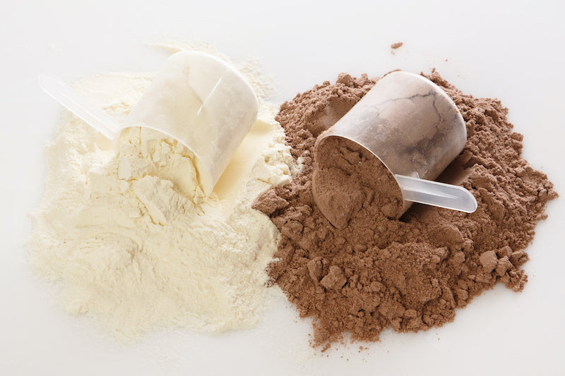 Two scoops of flavored protein powders