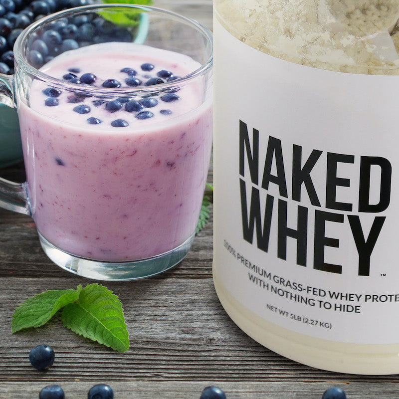 Naked Whey product next to a blueberry protein shake