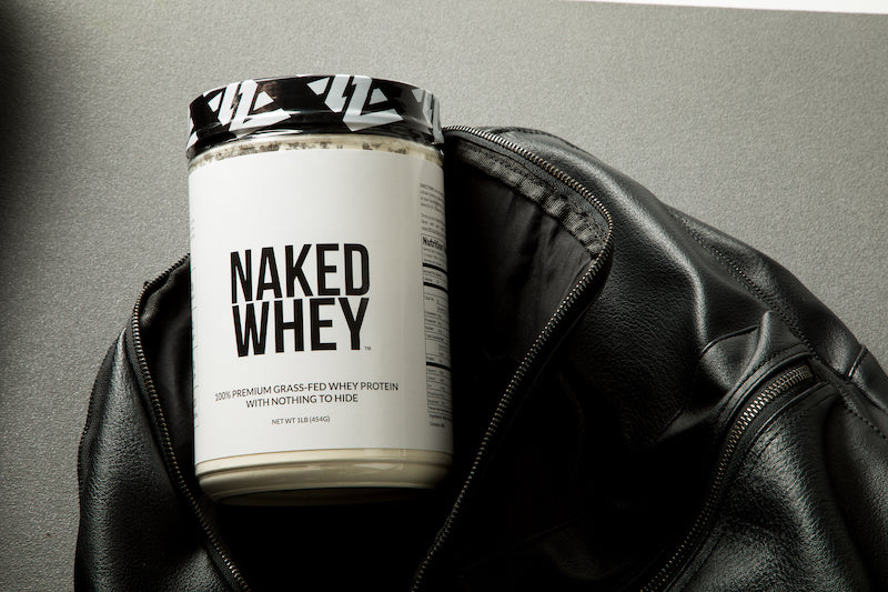 One pound tub of Naked Whey in a gym bag