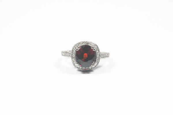 White Gold Ring with Oval Garnet and Diamonds