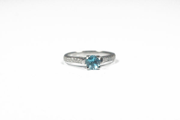 White Gold Ring with a Round Blue Topaz Center and Diamonds