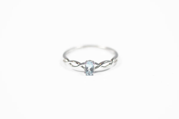 White Gold Blue Topaz Birthstone Ring
