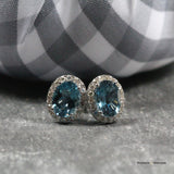 White Gold Blue Topaz Halo Stud Earrings