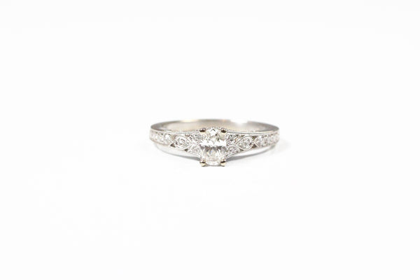 White Gold Engagement Ring with an Oval Diamond Center
