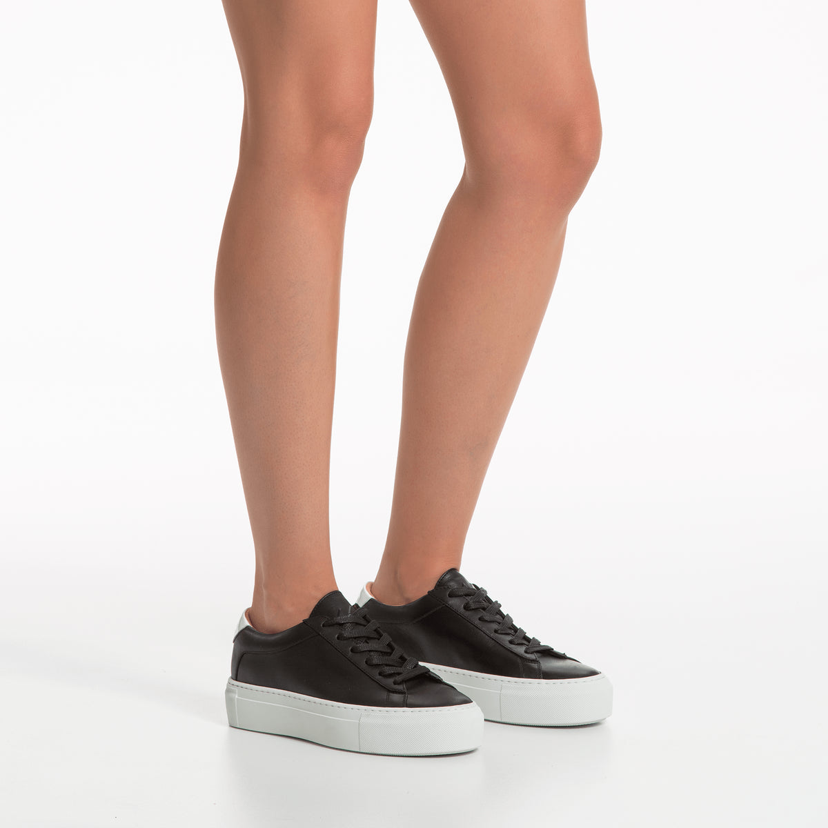 white and black platform sneakers