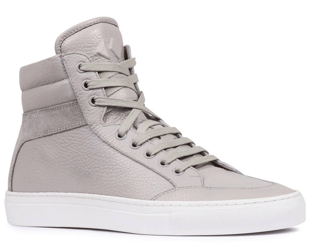 3257d4cddec673 Our signature high-top sneaker in pebble-grain leather and soft calfskin  suede.