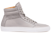 Our signature high-top sneaker in pebble-grain leather and soft calfskin suede. Handmade in Italy.
