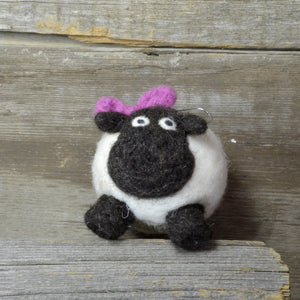 sheep with bow ornament