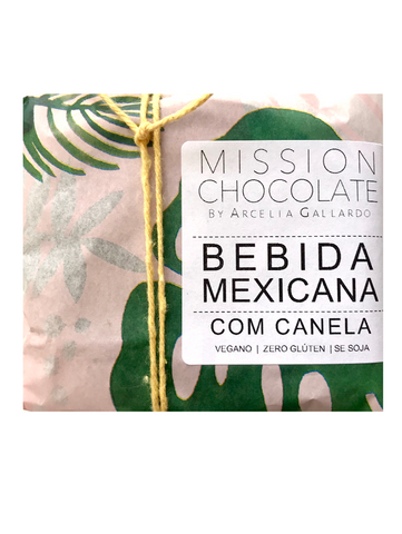 pink and green paper with label that reads Bebida Mexicana com canela