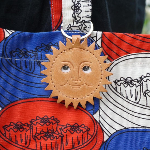 The Sun the emoji keychain