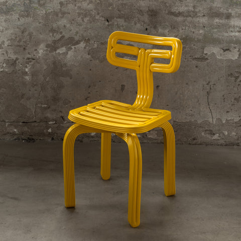 featured - chubby chair yellow dirk vander Kooij recycled plastic robot print