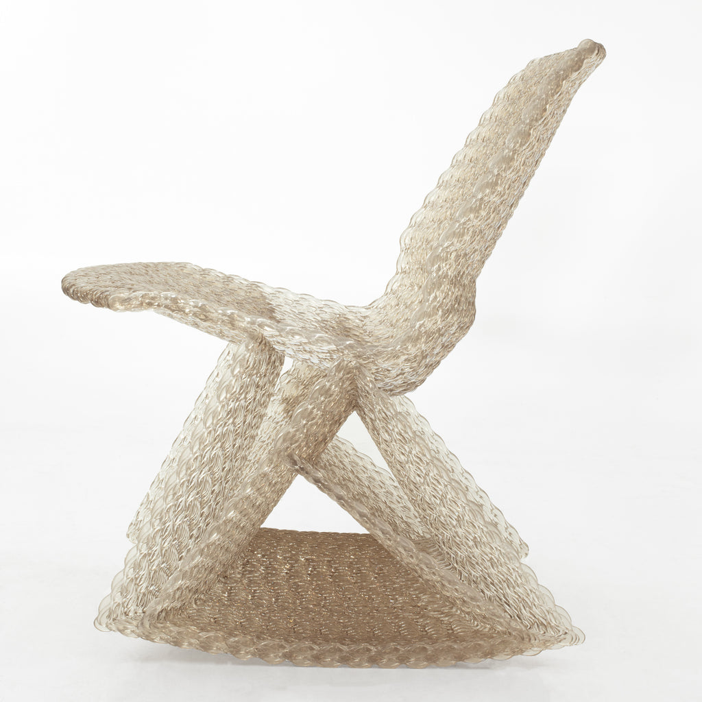 Endless rocking chair made out of recycled material with a 3D print robot by dirk vander kooij