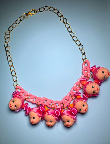 DOLL HEAD NECKLACE