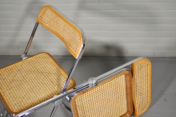 Four 'Plia' chairs by Giancarlo Piretti for Castelli