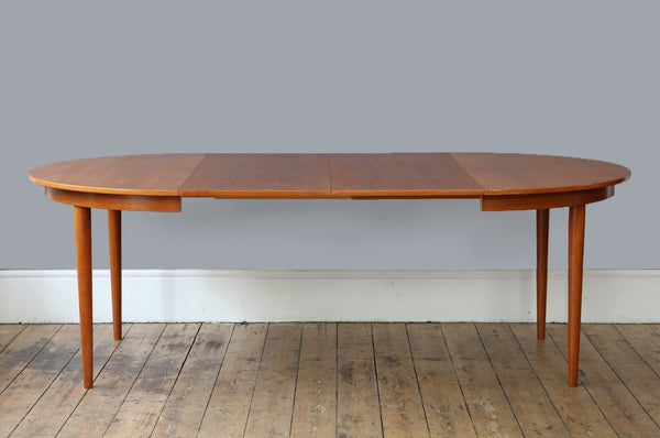 Extendable Round Light Teak Dining Table