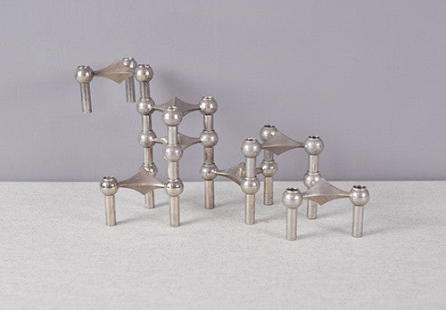 Sculptural chrome candle holders by Nagel.