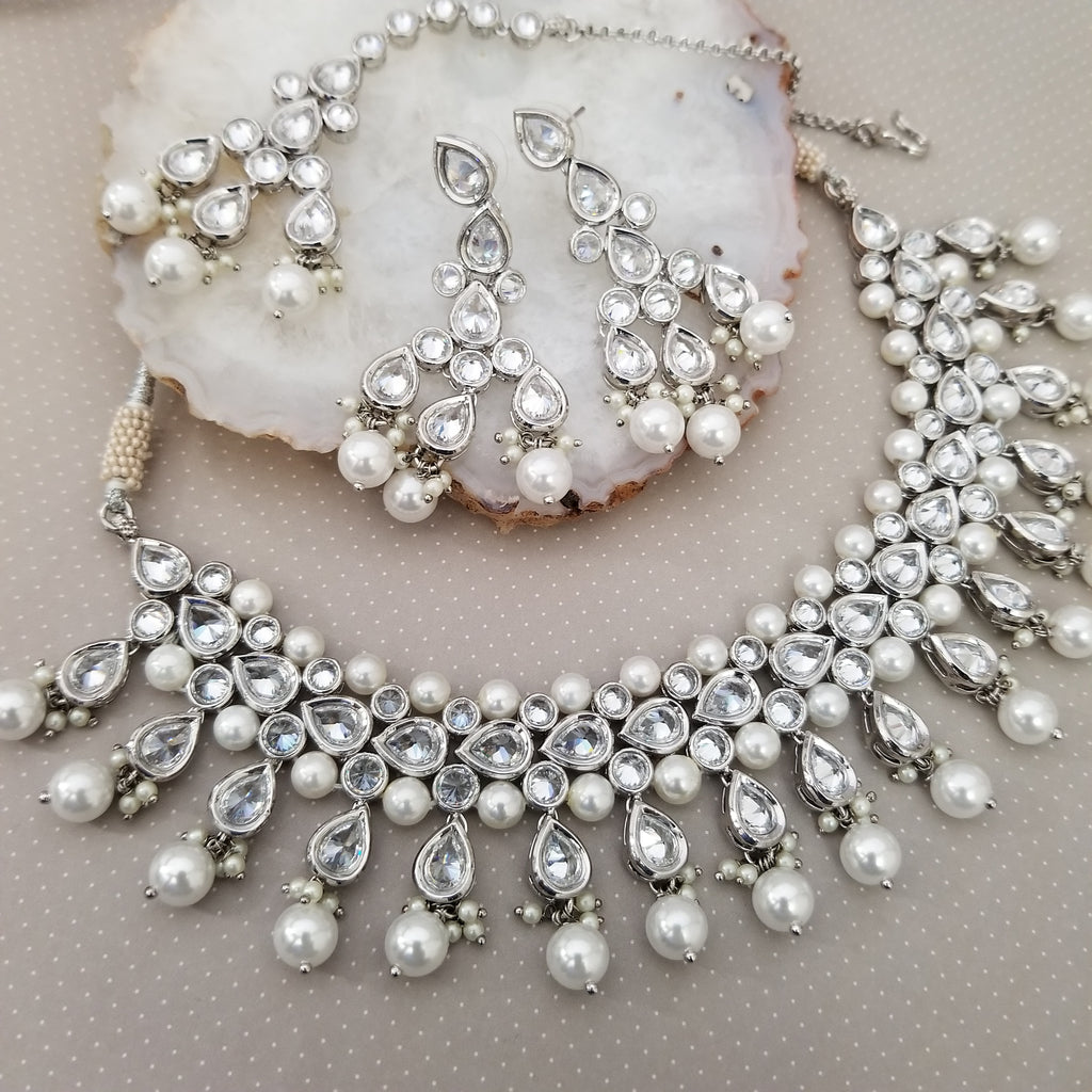Silver necklace set with white zircon diamonds and pearl accents