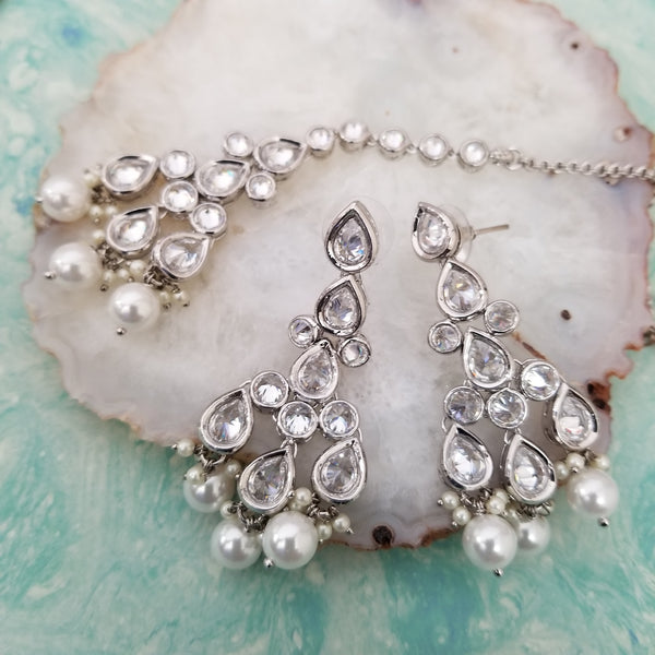 silver earrings and tikka with white zircon diamonds and pearl accents