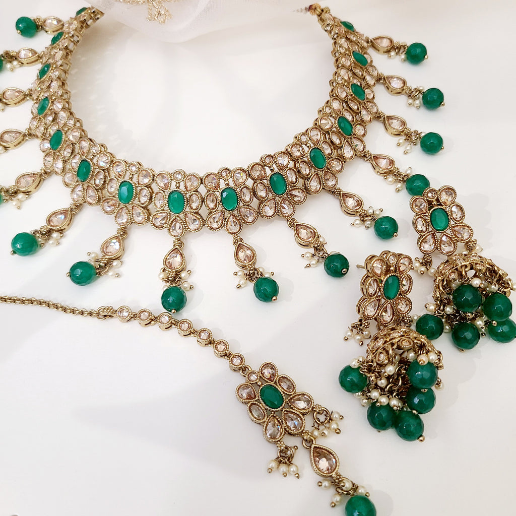 South Asian choker necklace set with gold zircon diamonds and emerald green accents